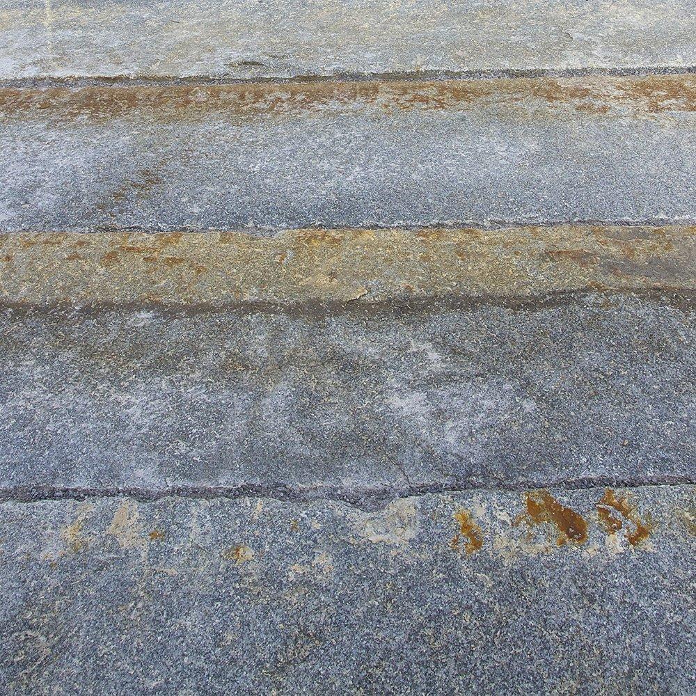 Reclaimed-third-generation-granite-curbstone-plank-paver-closeup