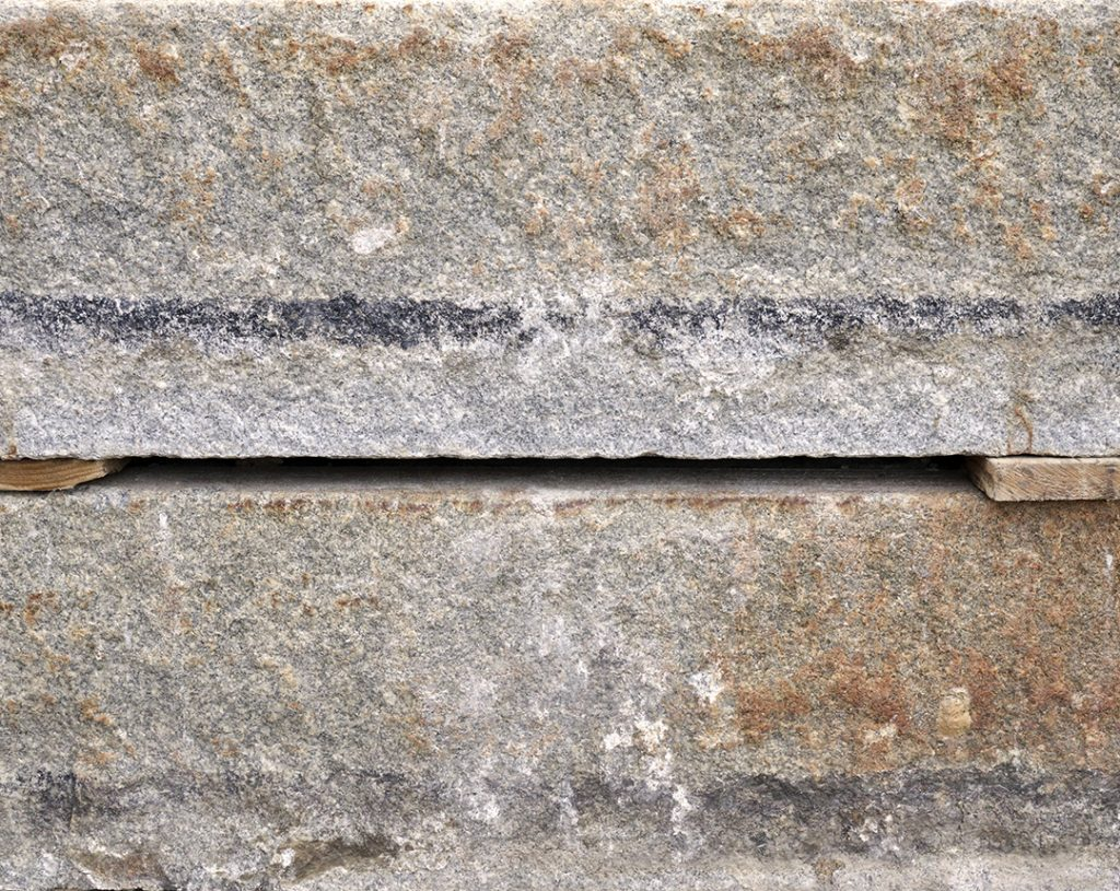 Reclaimed-third-generation-granite-curbstone-plank-material-1080x860-1