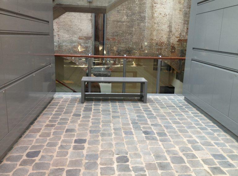Reclaimed European porphyry sliced cobblestone interior floor - Stone Curators