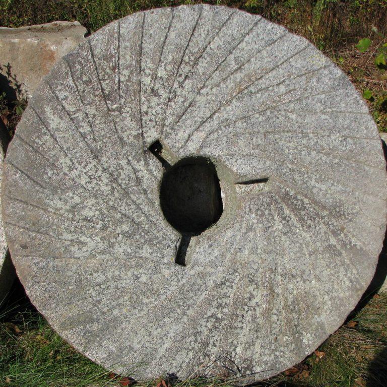 Reclaimed granite millstone - Stone Curators