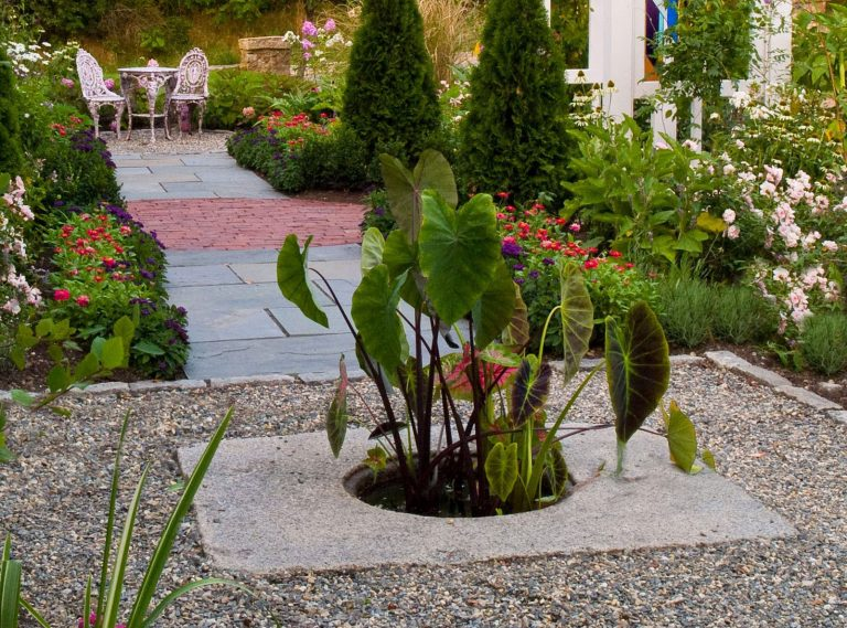 Reclaimed manhole cover used as decorative planter - Stone Curators
