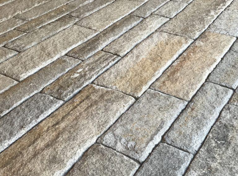 Reclaimed second generation curbstone closeup