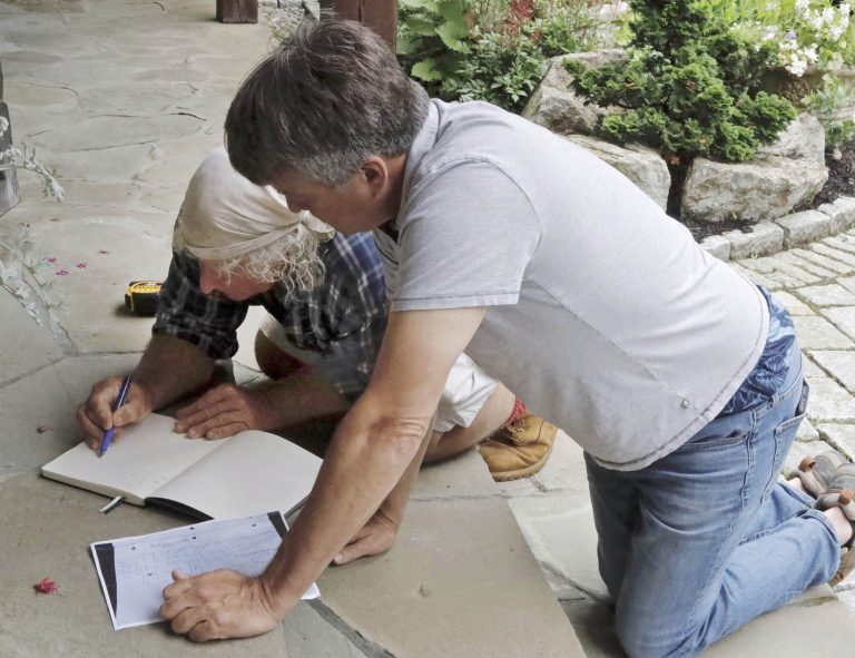Stone-Curators-Gavin-Johnston-and-contractor-sketching-ideas-and-making-list_MG_1078