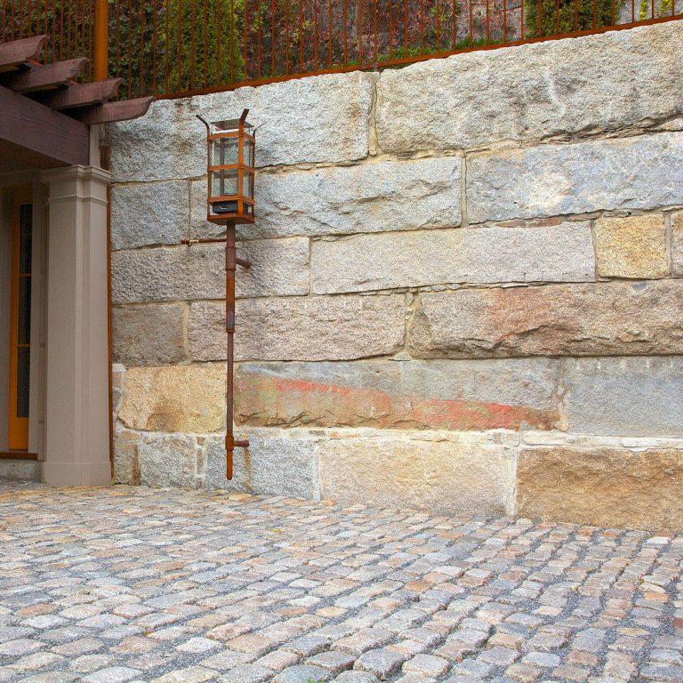 Reclaimed bridge block retaining wall square