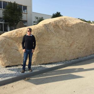 Gavin Johnston in front of large Chinese boulder image
