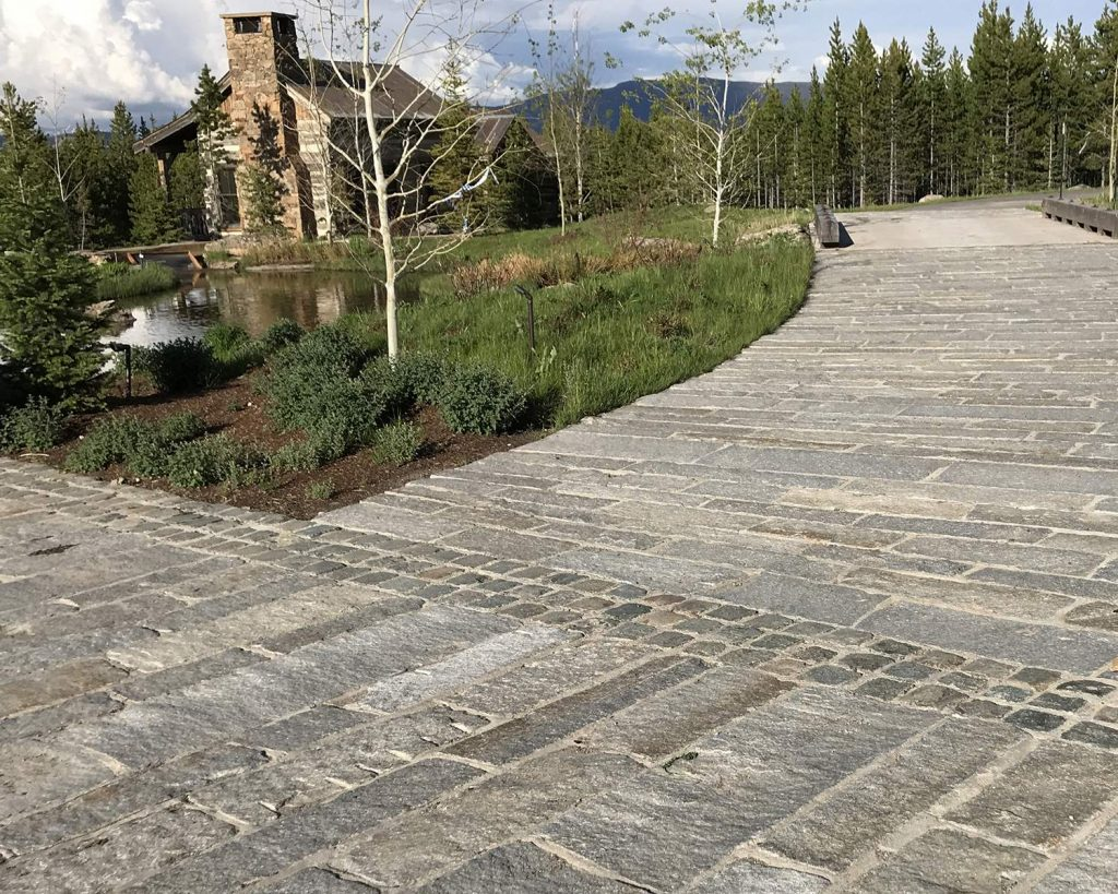 High Alpine Ranch with reclaimed plank and cobblestone driveway 6