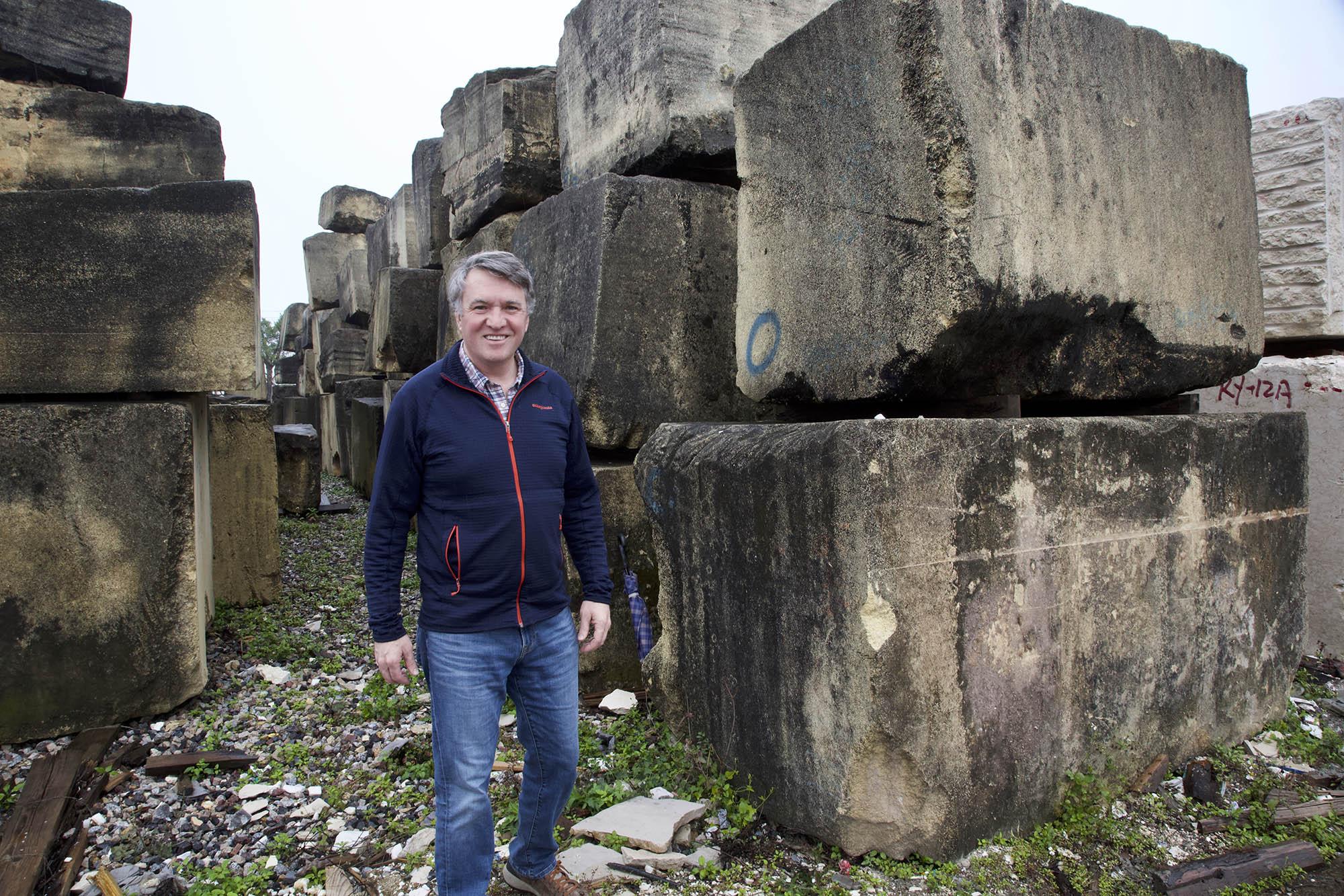 Gavin in front of large blocks