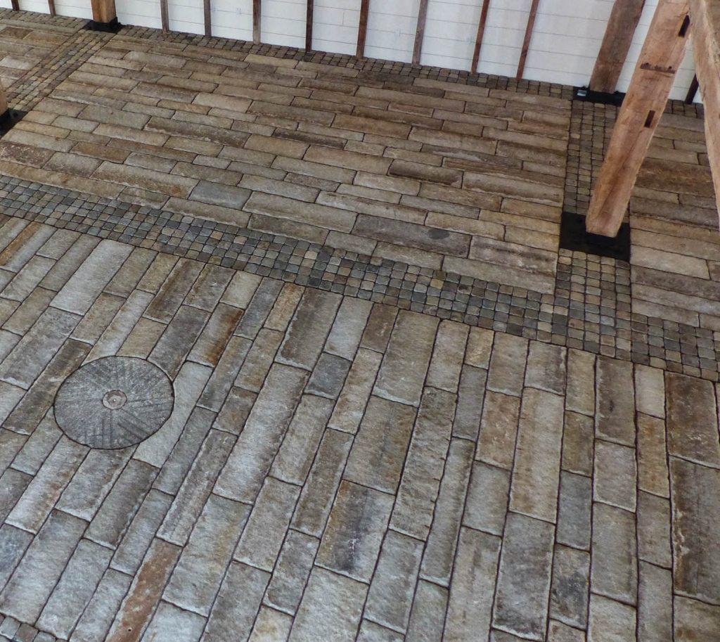 Reclaimed planks and cobblestone barn floor