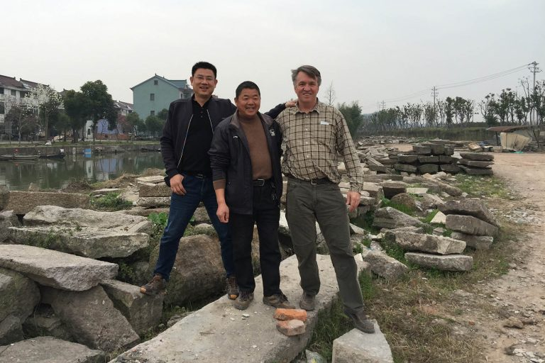 Gavin and two Chinese colleagues in stone yard