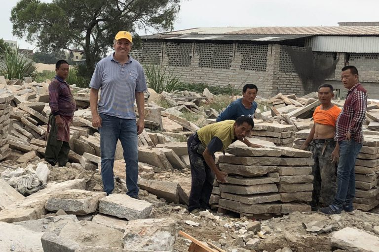 Gavin and workers in Chinese stone yard