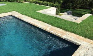 Reclaimed granite curbstone pool coping