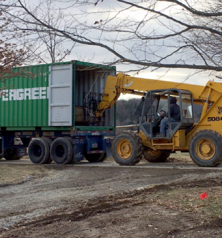 Stone-Curators-loading-stone-into-shipping-container@2x